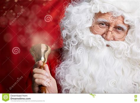 traditional santa claus ringing on traditional santa claus ringing on a bell concept xmas stock photo image 80077058