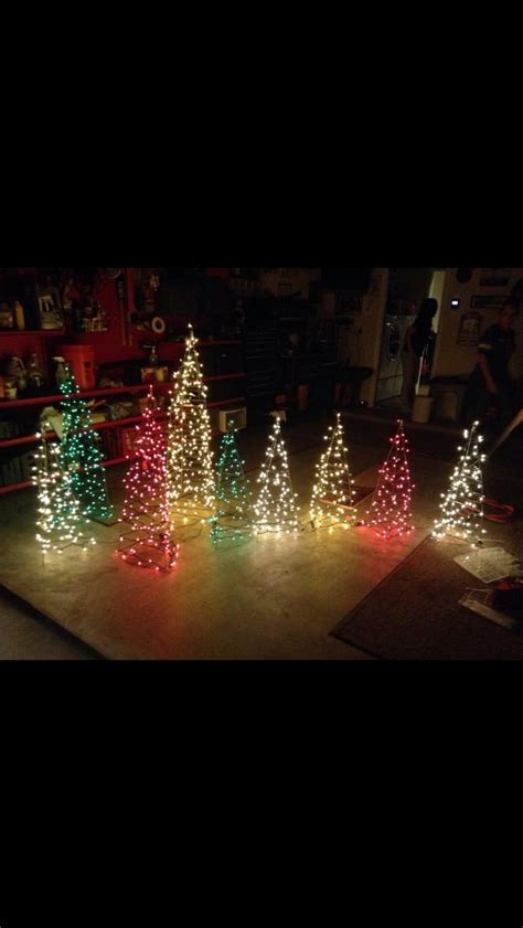 decorating trees with christmas lights christmas yard decor trees made out of tomato cages and