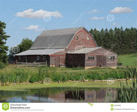 Old Wooden Farm Barn In The American Prairie. Stock