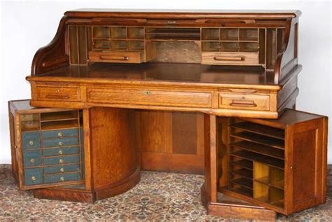 Wooton oak roll top desk with rotary sides. The rotary