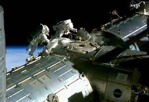Water pools in US astronaut's helmet after spacewalk ...