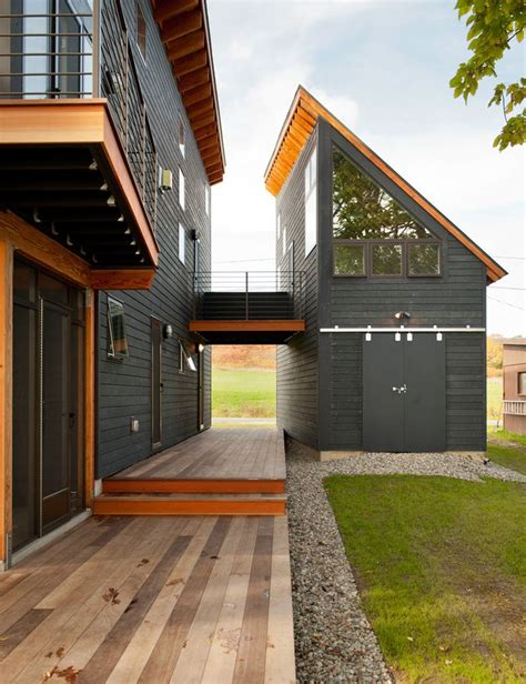black house  angled roof balcony barn doors breezeway