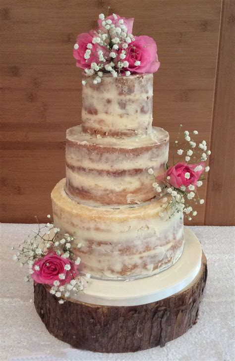 tier semi naked wedding cake  fresh roses