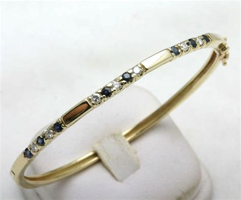 Estate 14k Yellow Gold Diamond & Blue Sapphire Bangle. Unicorn Rings. Diana Engagement Rings. Hope Bracelet. Strength Bracelet. Unique Necklaces. Jewelry Brooch. Artsy Wedding Rings. Mystic Topaz Pendant
