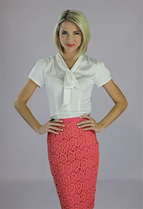 Elegant Satin Blouse That Features A Tie Neck And Just