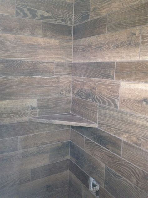 wood tile walls  shelf  shower bathrooms