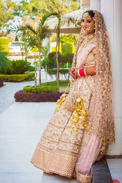 breezy punjabi wedding   pastel pink bride