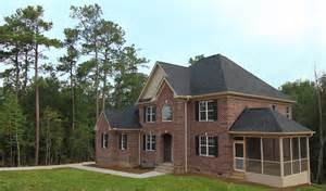side split house plans all brick two story home apex home builders stanton homes