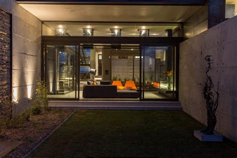 glass sliding doors garden exposed concrete wall