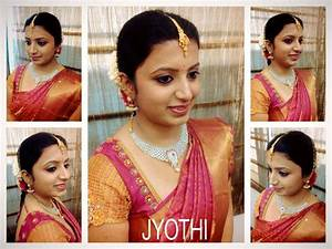 Traditional Southern Indian bride wearing bridal hair, saree and jewellery Engagement look
