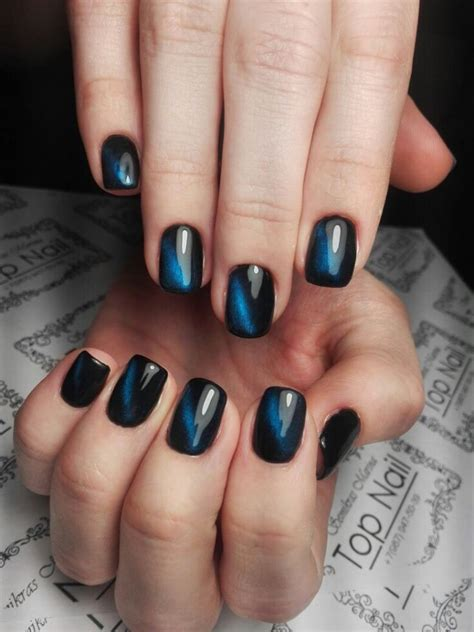 stylish manicure black  blue nail polish technology