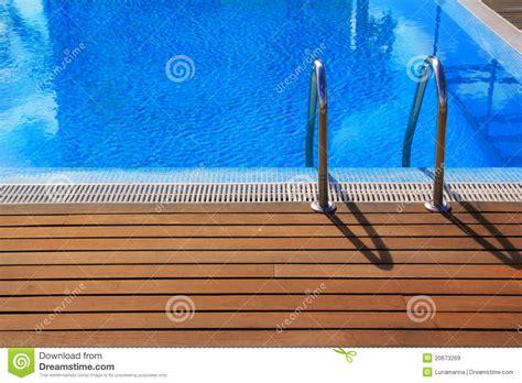 blue swimming pool  teak wood flooring stock image