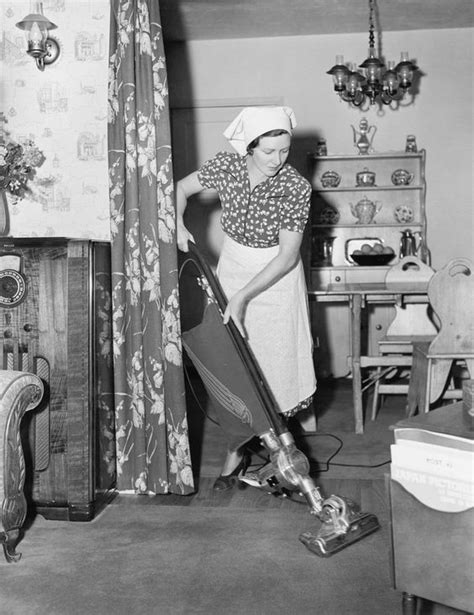 40's housewife with the big heavy Vacuum cleaner