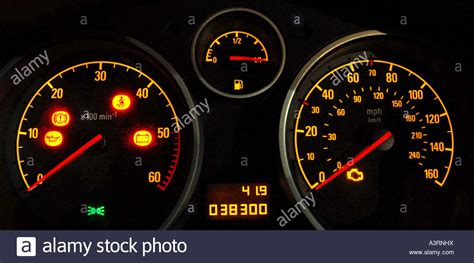 Car Dashboard Dials Showing Warning Lights And Full Tank