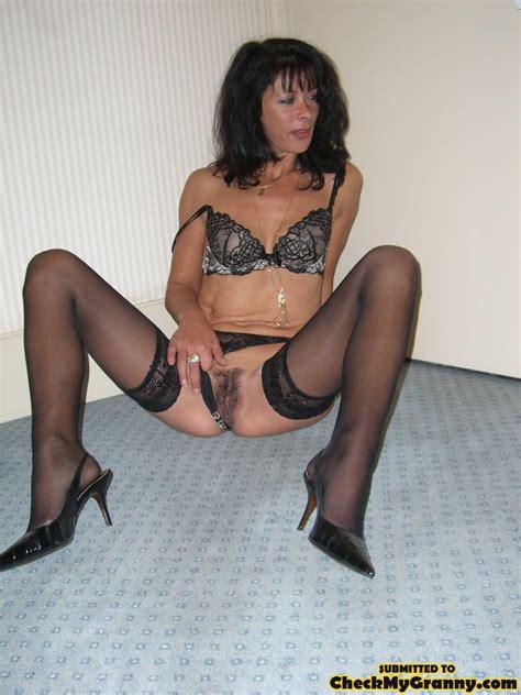 dark haired mature babe in sexy lingerie an xxx dessert