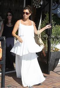 Kourtney Kardashian drapes her huge baby bump in a flowing ...