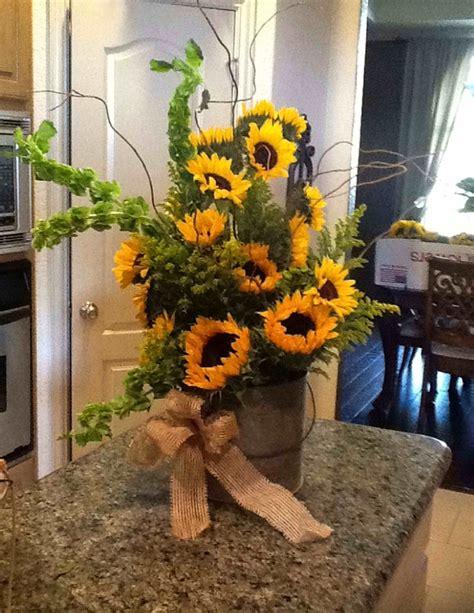 sunflower arrangement  rustic wedding  elegance