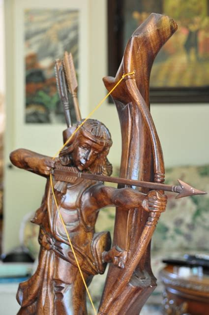 wood carved sculpture   native american shooting