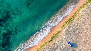 Aerial View Of Ocean Waves And Sand On Beach Stock Photo ...