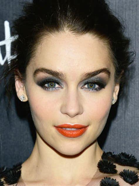 weekend beauty inspiration emilia clarkes daring smoky eye  orange lip combo allure