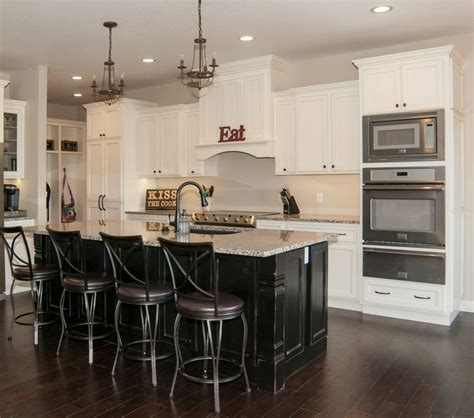 Maple painted off white/black   Schmidt Custom Cabinetry