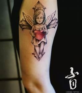 Kreuz Tattoo Oberarm : engel tattoo designs mit bedeutungen 30 ideen ~ Frokenaadalensverden.com Haus und Dekorationen