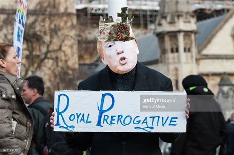 Protester wearing a mask of US President Donald Trump ...