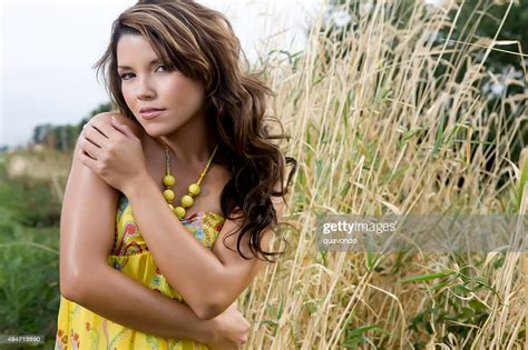 Cute Latina Girl Standing Outside In Field Of Grass High