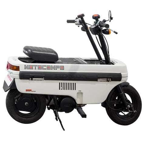 """Honda NCZ 50 Motocompo, AB12, Trunk Bike"" by Honda Motor"