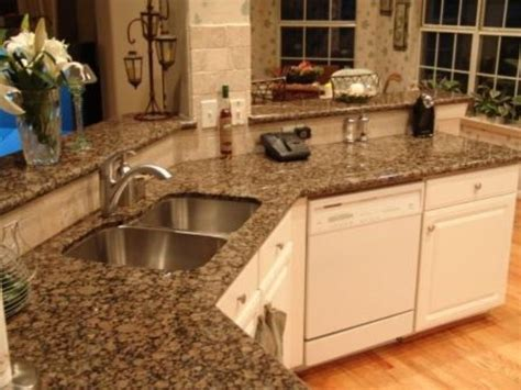 baltic brown granite countertops light maple floors add
