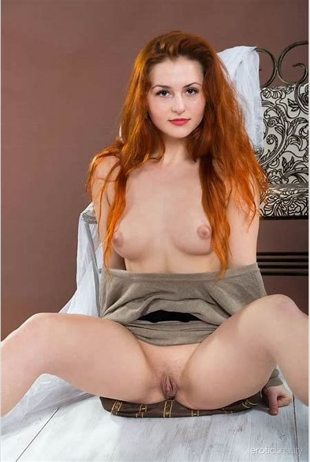 Hot babe with long red hair getting naked - Snbabes.com