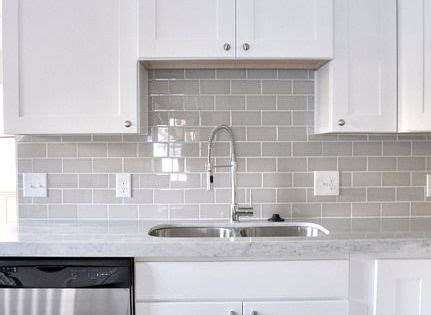Smoke Gray glass subway tile, white shaker cabinets, pull