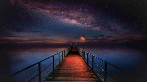 Ocean Pier Under Milky Way Sky 4k Ultra Hd Wallpaper