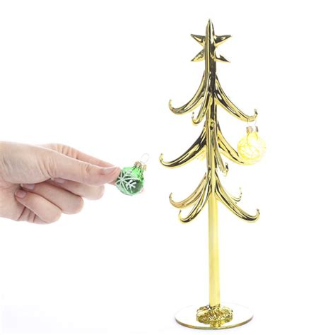 gold christmas tree with ornaments christmas trees and
