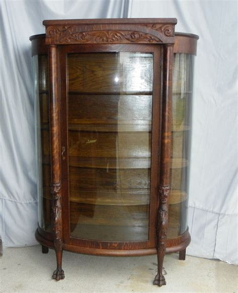 antique curio cabinets antique oak china or curio cabinet heads and claw
