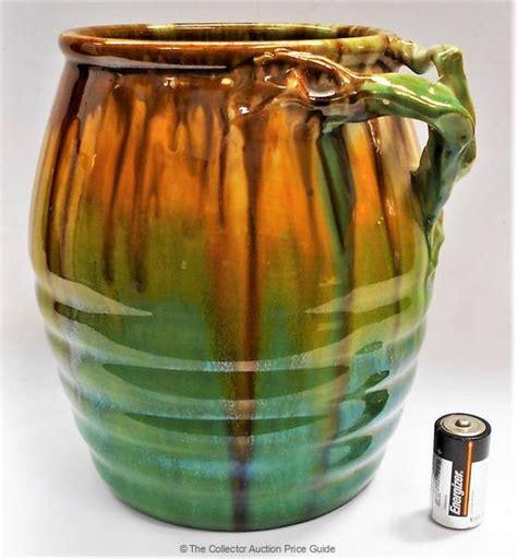 large remued australian pottery vase  branch handle