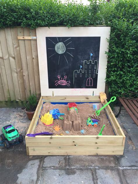 homemade sandpit  decking board   blackboard lid
