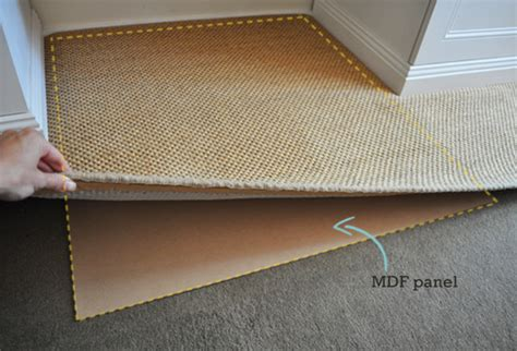 Stop Rugs Moving by How To Keep A Rug In Place On Carpet The Painted Hive