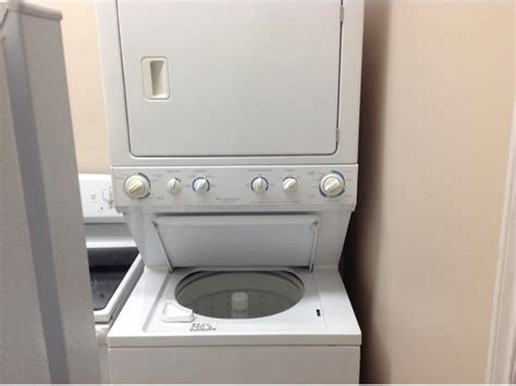 Used stackable Kenmore washer/dryer combo..taxes in