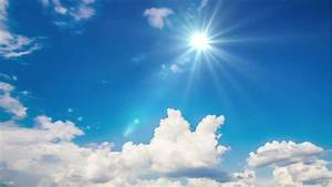 Sun In The Sky. White Clouds And Bright Sun. Scope And ...