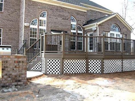 composite decks  metal railing  white lattice