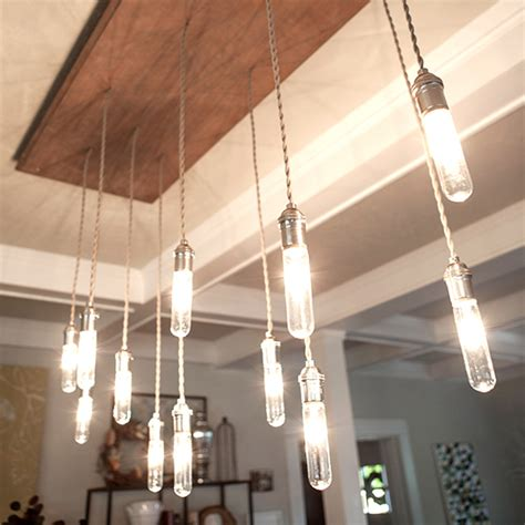 Industrial Edison Style Chandelier (video)  Lia Griffith. Leathered Granite Countertops. Mosaic Tile Kitchen Backsplash. Tan Couch. Exterior Shutters. Kitchen Cabinet Pulls. Red Cabinets. Tuscan Style Homes. Contemporary Sofas