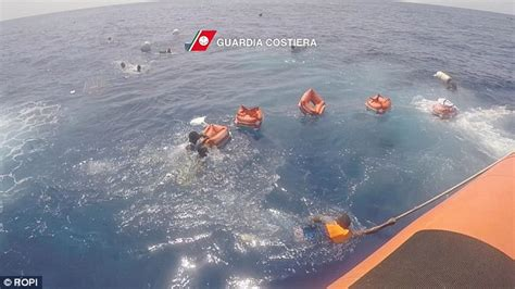 Sea Born Boat Problems by Italian Coast Guard Holds A Baby Moments After S