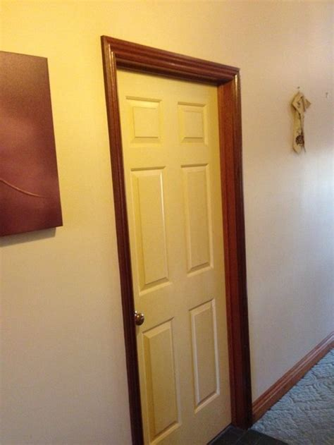 soundproof an apartment white interior doors with stained wood trim photo