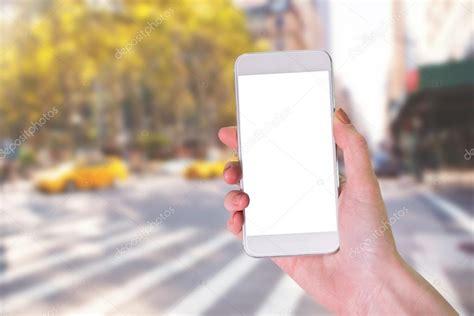hand holding smartphone stock photo  wavebreakmedia