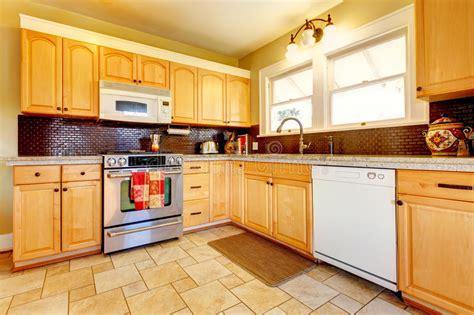 light tones wood kitchen  brick backsplash design