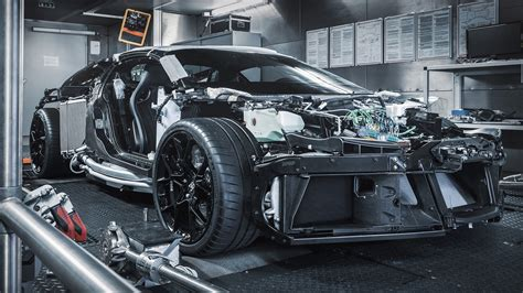 And the reborn w16 puts out up to 1,825 hp and 1,850 lb. Naked Bugatti Centodieci Exposes the Astonishing Engineering Around the 1,600-HP W16