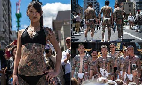 foto de Yakuza tattoos on show as men and women hit the streets of