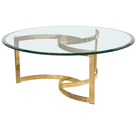 The newton coffee table has a base with a sinuous and sculptural design, a perfect match for its glass top. 2020 Best of Round Glass Coffee Tables Wood Base
