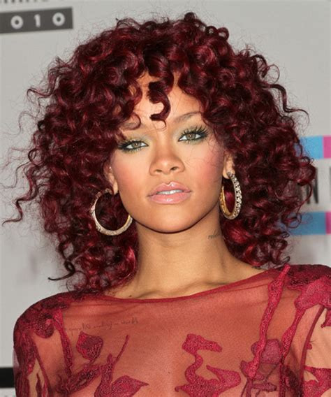 rihanna medium curly casual hairstyle red hair color